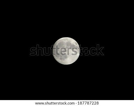 The moon isolated in dark sky - stock photo