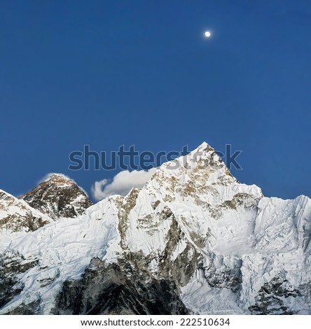 The Moon, mount Everest (8848 m), and Nuptse (7864 m) after sunset (view from Kala Patthar) - Nepal, Himalayas - stock photo
