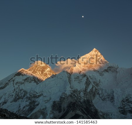 The Moon, mount Everest (8848 m), and Nuptse (7864 m) in the evening (view from Kala Patthar) - Nepal, Himalayas