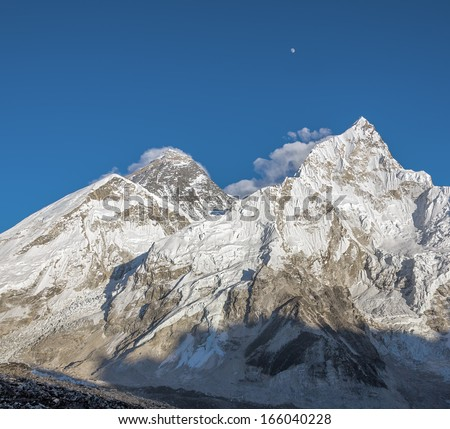 The Moon, Mount Everest (8848 m), and Nuptse (7864 m). View from Kala Patthar - Nepal, Himalayas