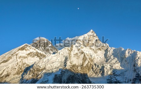 The Moon, Mount Everest (8848 m), and Nuptse (7864 m). View from Kala Patthar - Nepal, Himalayas - stock photo