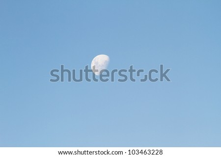 The Moon on a dusky daylight sky. - stock photo