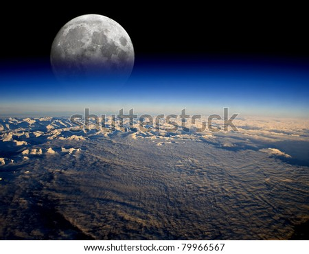 The Moon rises over planet Earth - stock photo
