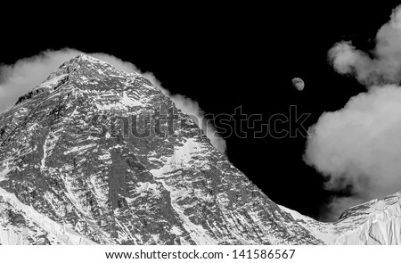 The moon rises over the Mt. Everest (8848 m) on the South Col (view from Kala Patthar) - Nepal, Himalayas (black and white)