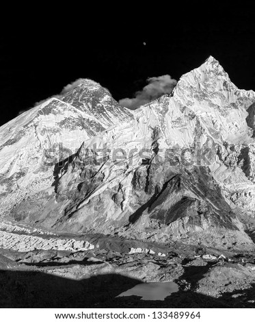 The moon rises over the Mt. Everest (8848 m)  (view from Kala Patthar) - Nepal, Himalayas (black and white)