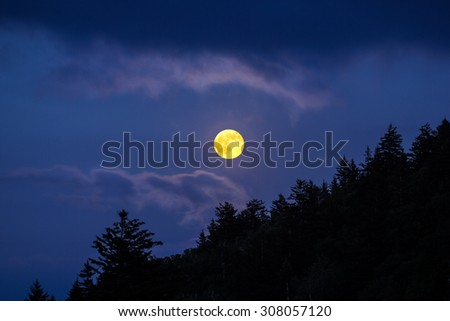 The moon rising over a ridge in the Blue Ridge parkway, South Carolina - stock photo