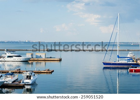 The moored yachts stand on an anchor. Night sky with blue clouds. still water - stock photo