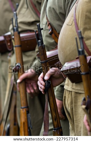 the Mosin rifle in hands of soldiers  - stock photo