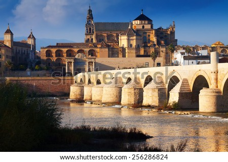 The Mosque-cathedral of Cordoba and Roman bridge.  Spain - stock photo
