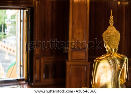 The Most Beautiful Golden Buddha ; backside of golden sitting buddha sculpture  - stock photo