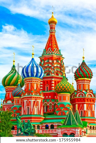 The most famous architectural place for visiting and attraction in Moscow, Russia, Saint Basil's cathedral with colorful cupolas and spectacular domes in traditional culture on cloudy blue sky - stock photo
