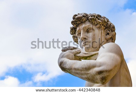 The most famous statue in Florence, David of Michelangelo, Italy isolated in the blue sky whit clouds - stock photo