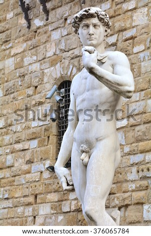 The most famous statue in Florence, David of Michelangelo; Italy; the perfect statue of a man in marble. - stock photo