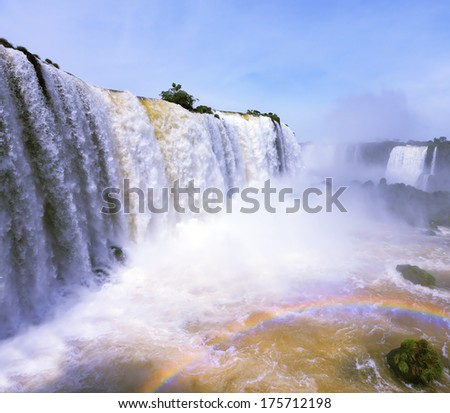 The most high-water waterfall in the world - Iguazu. Boiling water foam, crashing and falling jets, a fine mist over the water. The Brazilian side
