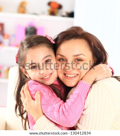 The mother with her daughter. - stock photo