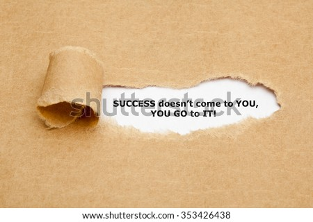 The motivational quote Success does not come to You, You Go to It appearing behind torn paper.