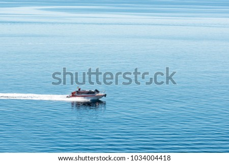 The motor boat swiftly sails across the Mediterranean.
