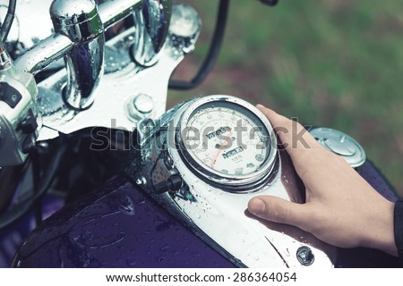 the motorcycle driver Stoke gas tank and speedometer of his bike - stock photo