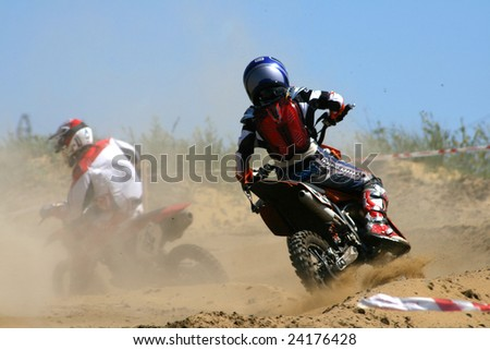 The motorcyclist makes abrupt turn in conditions of the limited visibility - stock photo