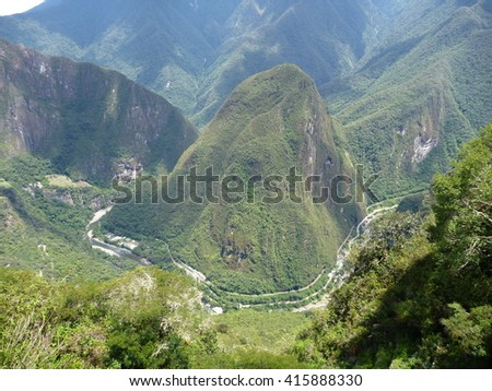the mount putucusi at urubamba valley seen from machu picchu
