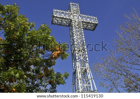 The Mount Royal Cross is a monument on top of Mount Royal in Montreal, Quebec, Canada. It stands at the northeastern peak of the mountain and overlooks the eastern part of the island. - stock photo