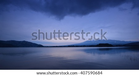 The mountain Fuji at dawn with peaceful lake reflection - stock photo