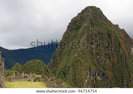 The mountain Huayna Picchu, or Wayna Picchu, which means Young Peak in Quechua, rises over the ruins of Machu Picchu, Peru