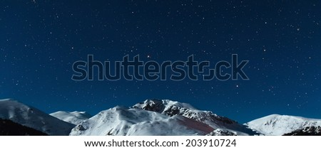 the mountain in moonlight and stars sky - stock photo