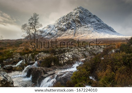 The mountain is Buachaille Etive Mor which rises above Rannoch Moor to a height of 1022m It is located in  Glencoe in the Lochaber region of Scotlands Highlands - stock photo