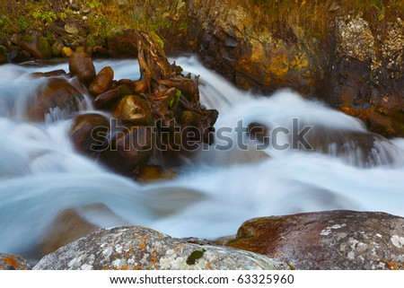 The mountain river in the autumn - stock photo