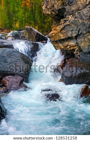 the mountain river with rocks - stock photo