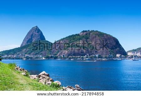 The mountain Sugar Loaf and Guanabara bay in Rio de Janeiro. Brazil - stock photo