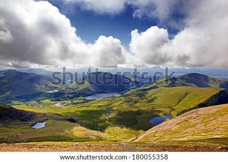 The mountains and lakes of Snowdonia, looking from Mount Snowdon from the Llanberis Pass - stock photo