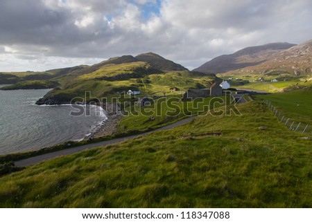 The Mountains and road in Roghadel in the Outer Hebrides - stock photo