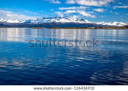 The mountains of Tierra del Fuego as seen from the Beagle Channel - stock photo