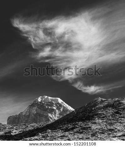 The mountains peak Gyachung Kang with beautiful clouds - Gokyo region, Nepal, Himalayas (black and white) - stock photo