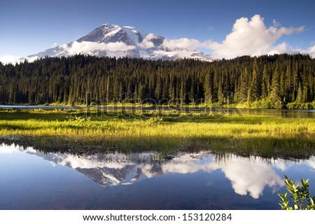 The mountains reflection is shown in Reflection Lake inside the park