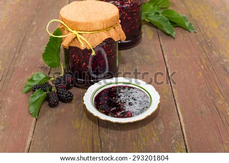 The mulberry jam and mulberry fruit on branch black