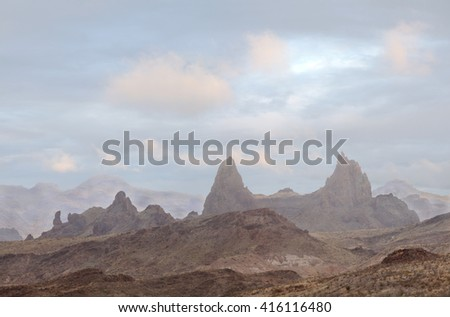 The Mule Ears in Big Bend National Park as the Fog Lifts - stock photo