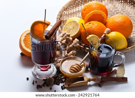 The mulled wine with spices and fruits - stock photo