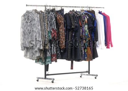 The multi-coloured clothes hangs on a hanger - stock photo