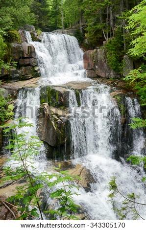 The multiple cascades of lovely Katahdin Stream Falls, Baxter State Park, Maine, USA - stock photo