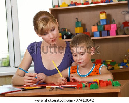 The mum with son is engaged in a children's room