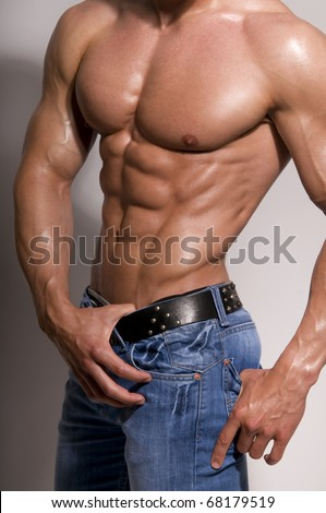 The muscular male body  on white background. - stock photo