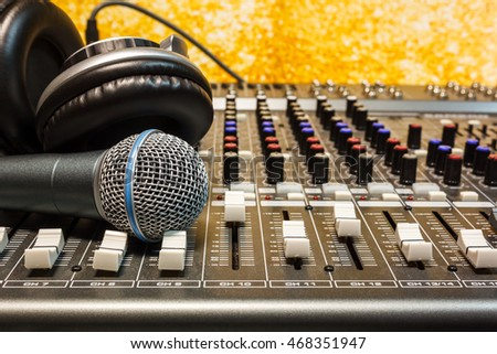 The music instruments or dj  equipment concept the headphones and microphone on sound mixer music background.
