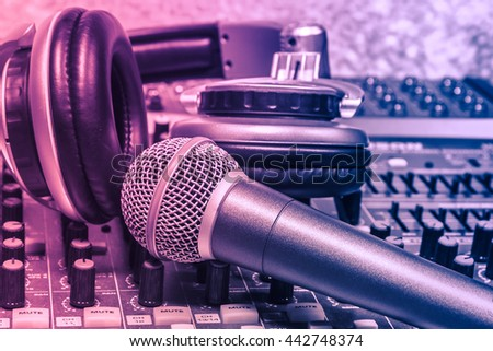 The music instruments or dj  equipment concept the headphones and microphone on sounnd mixer music background. - stock photo