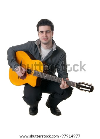 The musician plays an acoustic guitar, isolated