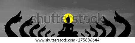 The naga black silhouette and the Buddha on gray cloud background - stock photo