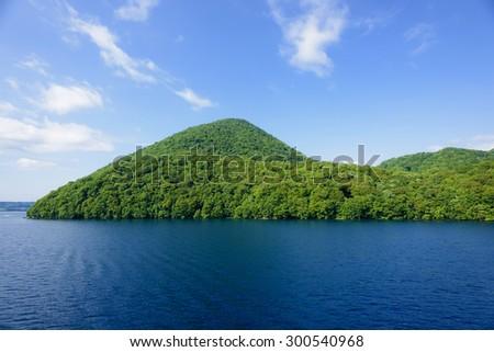 The Nakajima, one of the four islands in Lake Toya. - stock photo