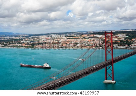 The name bridge on April, 25th through the river Tagus in Lisbon, Portugal - stock photo